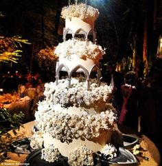 Lavish: The couples wedding cake can be seen among the forest setting at the celebrations in Big Sur