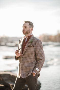 Earth Wind Fire Water - groom - pipe - paisley pocket square - leather wrapped boutinir - plaid tweed suit jacket - beecroft & bull - wedding on the river Styled by Wright Event Services Photography: Andrea Pesce Photography - www.andreapesceph... Read More: www.stylemepretty...