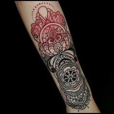 Incredible ink art on a forearm made of geometric shapes and ornaments and full of small details