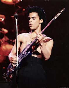 Prince prince playing purple flower guitar