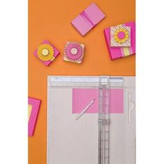 """ACM - $39.99 Martha Stewart Deluxe Score Board W/Trimmer -13.75""""X19.5"""" $23.94 @ Jet Create cards, envelopes, frames, rosettes, gift boxes, tags and more with just one tool! The score board contains grooves at every 1/8 inch for straight cuts. This package contains one 16x15 inch adjustable deluxe scoring board with a paper trimmer and blade cover, one stylus for crisp scoring and embossing, seventeen step-by-step templates, one envelope guide and one instruction booklet. Imported."""