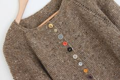 really like the simple garter stitch sweater and using different color buttons