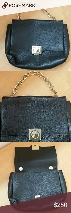 89eba5325c Versace handbag 100% authentic Black Versace handbag with gold chain. 100%  authentic.
