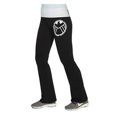 Black yoga pants feature a print of the S.H.I.E.L.D. (Strategic Hazard Intervention Espionage Logistics Directorate) logo on the left thigh. The white foldover waist has S.H.I.E.L.D. printed in white ink across the back.