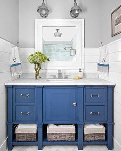 Neutral hues allow this nautical bathroom's rich blue vanity to take center stage. Neutral hues allow this nautical bathroom's rich blue vanity to take center stage. Blue Bathroom Vanity, Blue Vanity, Bathroom Vanity Designs, Bathroom Colors, Bathroom Vanities, Colorful Bathroom, Bathroom Sconces, Bathroom Storage, Small Vanity
