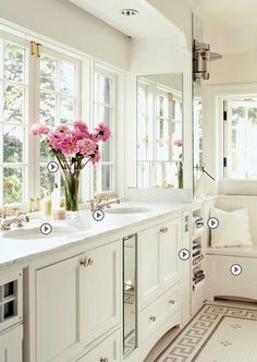 Double vanity maximized and I love the comfy bench nestled in front of the window and the cozy space for folded towels.