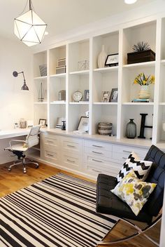 Built-in cabinets along the side walls? Could make one wall full cabinets and the opposite wall desk + cabinets