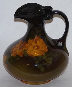 Like this alot - good sized Rookwood Pottery ewer decorated with large yellow flowers and leaves Really wonderful color and artwork. Roseville Pottery, Pottery Vase, Vintage Pottery, Vintage Ceramic, Rockwood Pottery, Craft Accessories, Glass Collection, Porcelain Ceramics, American Art