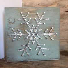 This mini snowflake string art adds the perfect touch to a shelf or mantle. This… This mini snowflake string art adds the perfect touch to a shelf or mantle. This custom made string art. Crafts To Do, Christmas Projects, Holiday Crafts, Wood Crafts, Arts And Crafts, Anchor String Art, Nail String Art, String Wall Art, Cool Christmas Trees