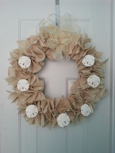 DIY Burlap Wreath with Sand dollars: Featured on http://thestylishnest.com/windows-into-warmer-weather-diy-beachy-burlap-wreath-for-whimsical-doors-and-windows/