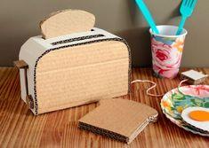 Mom's cardboard toy creations include a PAC-MAN console, Super 8 camera & a boom box Cardboard Kitchen, Cardboard Crafts Kids, Cardboard Playhouse, Cardboard Paper, Paper Toys, Cardboard Furniture, Diy Karton, Cardboard Sculpture, Cute Crafts