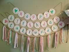 """Custom """"happy birthday"""" banner made by hand using paper doilies, marker and twine."""