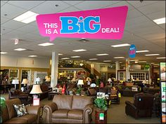 """Ceiling signs and more are all themed as Speech Balloons for this furniture showroom """"Big Sale. Balloon Ceiling, Speech Balloon, Retail Stores, Furniture Showroom, Hanging Signs, Balloons, Purple, Big, Color"""