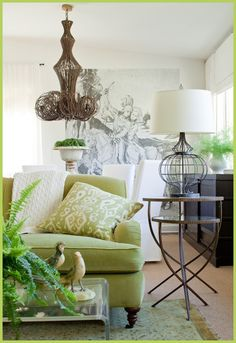 White walls, lime green furniture, natural and dark elements for contrast.  Nice.