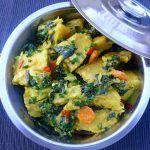 Oil Down (Grenadian stew of cod, greens, spices, coconut milk)