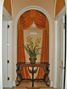 This style of curtaining is usually sooo dated but here it looks wonderful.   The arched Swag & Jabots w/Side Panels matching the arched wall above the doors in colour and style!