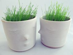 Whimsical white ceramic planters by Marie-Louise Sundqvist