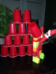 Sherman decided to build a pyramid out of red solo cups! :) Nice Lego ladder Sherman!