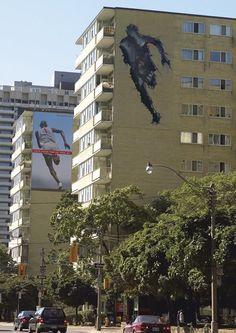Man running through buildings