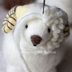 Tutorial with very detailed instructions on how to make needle felted sheep, Ramie. Ramie has a beautiful thick wool coat, big brown nose and rosy cheeks. #needlefeltingtutorials