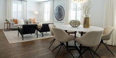 """Transform your dining room with Denali White Oak Hardwood in the color Gorge. This dark hardwood floor is hand stained and handcrafted to perfection by skilled artisans. Its oiled-finished matte visual in neutral, warm tones make it an ideal hardwood floor for living rooms and open spaces! Starting at $9.99 a SQ FT these 7 1/2"""" planks are finished with an aluminum oxide UV coating & a ThruColor™ Wear Layer."""