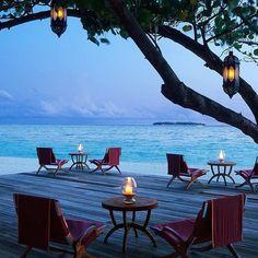 Beachfront drinks by candlelight at Taj Exotica Maldives.