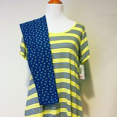 Love this cute Spring outfit! Yellow with blue beach like stripes and polka dot leggings!! Visit my page to learn more! www.facebook.com/lularoekatelynhansen