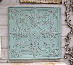 This fantastic old ceiling tin tile has been painted a soft aqua color over the bits of original beige colored paint and then buffed to bring out the pattern and patina of the metal. You can see the great texture of the old the chippy old paint in the close-up photos. The tin is clean and has been sealed on both front & back.