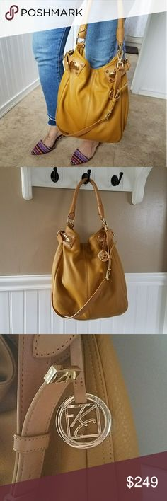 "Gorgeous Mustard Kenneth Cole Hobo Bag Beautiful mustard colored leather hobo with gold hardware by Kenneth Cole. Great used condition. Drop strap can be removed for simpler look, or left in place for chic style and versatility. Lining intact, with accidental pen markings only. Very slight blemish on corner as seen in last photo, but hardly visible at all. Top handle has 8"" drop, attached strap has 19"" drop. Kenneth Cole Bags Hobos"
