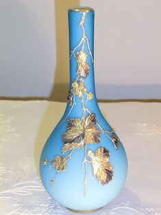 SIGNED HARRACH SKY BLUE SATIN GLASS VASE WITH GILDED DECOR OF LITTLE FLOWERS AND LEAVES IN RELIEF. Circa 1900 www.madforglass.com Little Flowers, Blue Satin, Glass Collection, Glass Vase, Leaves, Sky, Decor, Crystals, Recycled Crafts