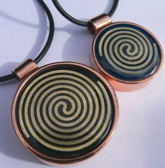 The Nu-me pendants have scalar waves embedded in the solfeiggo healing frequencies. The diameter of the regular size is 3.5cm which is suitable for a health challenged or electro sensitive person and small is 2.5cm in diameter, suitable for sensitive adults and children. NZ made. This also comes as a clip on in silver Electromagnetic Radiation, Saddle Bags, Swarovski Crystals, Copper, Pendants, It Is Finished, Acupressure, Face, Silver