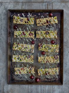 French glacé cherry energy bars with white chocolate drizzle
