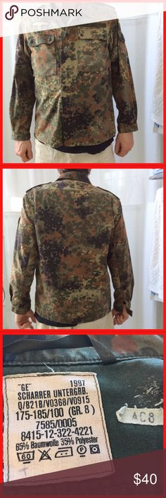 Men's Germany army shirt jacket camouflage camo This is a man's army shirt from Germany. It's dated 1997. It's a men's large.  Chest measures 22 inches across the front. And the back center length is 29 inches.  Snap and zip close. vintage Jackets & Coats Military & Field
