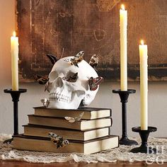 A skull adorned with artificial moths adds spooky style to any space. Try using … A skull adorned with artificial moths adds spooky style to any space. Try using it as Halloween mantel decor or perching it on a bookshelf. Table Halloween, Couples Halloween, Soirée Halloween, Classy Halloween, Holidays Halloween, Diy Halloween Books, Halloween Costumes, Halloween Stickers, Fall Mantel Decorations