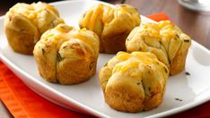 Rosemary, garlic and cheese make these monkey bread muffins perfect with any meal.
