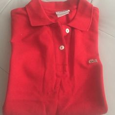 Red Lacoste Polo Lacoste polo in red. Size 38 in great condition . Please message with any questions Lacoste Tops Tees - Short Sleeve