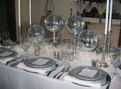 Tablescapes at Table Twenty-One, www.tabletwentyone.wordpress.com. This is one of my own creations using mirror balls and feathers to get a 1930's cabaret/nightclub feel.