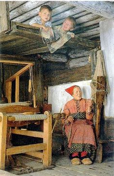 Here I am, spinning in my cabin and with visiting grandkids! Looks pretty fun! Illustration of the archaic way of life in one of the Russian regions. Spinning woman is an integral part of such life