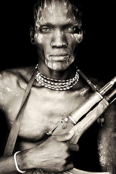 Meruti - very strong looking mursi boy from omo vally / ethiopia.  From African Portraits by Mario Gerth.