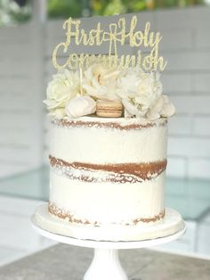 This beautiful cake topper features the phrase First Holy Communion in an elegant font with a cross in the middle. It would look great on top of the cake celebrating a First Communion. It measures approximately 7.5 W x 3.5 H. It is made of high quality glitter cardstock and really