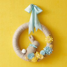 Greet the season with a DIY spring wreath. Hallmark Designer Em Bronson shares how to make a yarn-wrapped spring wreath perfect for Easter decorating.