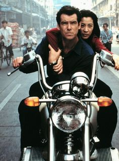 Pierce Brosnan as James Bond and Michelle Yeoh as Wai Lin Tomorrow Never Dies