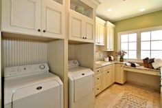Plenty of storage and countertop space make this laundry room a joy to work in. Intricate stonework on the floor adds unique artistic flair to the space.