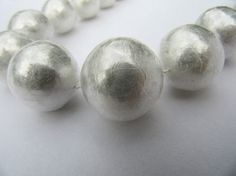 Julie Usel   cling film, silk thread  A collection of jewellery made with pearls built up by layers and layers of cling film.
