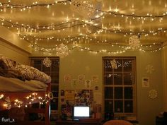 Using christmas lights not just for christmas. Use coffee hooks and string lights through