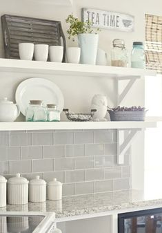gray glass tile back-splash, open shelving, white kitchen