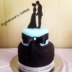 Wedding Cakes Tiffany Blue and Black with a little of bling bling in the bow and on the bottom of the cakes.