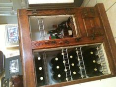 Antique icebox transformed into wine cabinet. If I ever found one, this would be a great project!