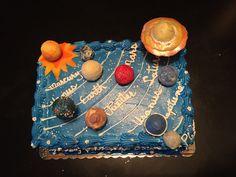 Solar system birthday cake. With cake pop planets.