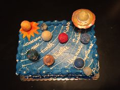 Solar system birthday cake. With cake pop planets.